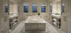 A brilliant and shining bathroom having the oval bathtub placed in the center of the room.
