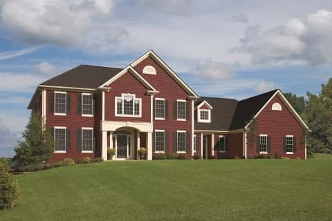 A Large Bungalow With Red Brick Walls, A Ton Of Beautiful Windows And A  Neatly