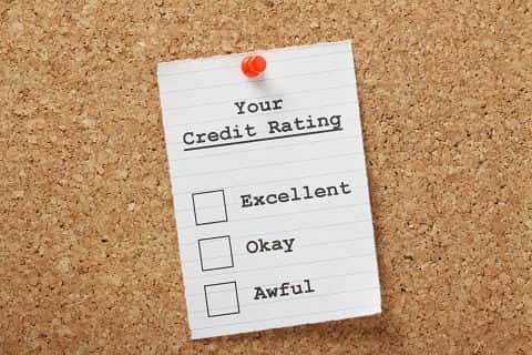"A checklist with ""excellent"", ""okay"" and ""awesome"" options on white paper against a wood background."