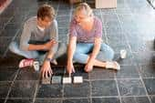 Young couple looks at flooring options - GettyImages/ZeroCreatives