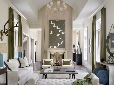 A Rectangular Shaped Living Room, Painted White And Filled With White  Furniture And Decor