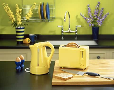 A section of the kitchen showing how yellow, lime and blue color themes can be blended to perfection.