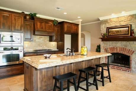 Kitchen and fireplace area of a house owned by Concept Builders, located in Sandsprings, Oklahoma.