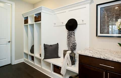 the hallway of the home and a hat lying on the hanger the hanger is - Better Homes Interior Design