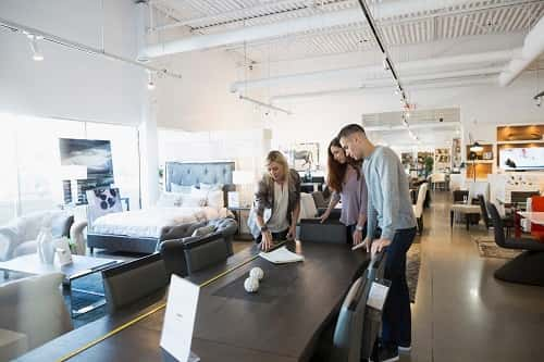 Couple picking out new furnishings for home - GettyImages/HeroImages