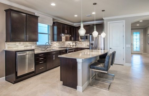 An Exotic Kitchen Model From DiVosta Homes With A Sink, Cabinets And A  Dining Table
