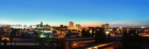 Lighted towers and streets of Downtown Fresno in a typical evening captured from the balcony of a tower.