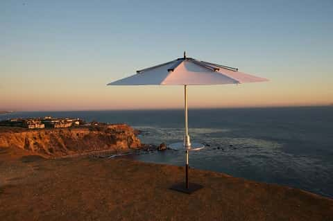 A parasol umbrella perfect for relaxing out in the sun, while still being able to charge electronic devices.