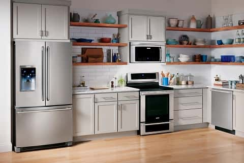 A White Themed Kitchen Full Of Electronic Appliances Made By The Electrolux  Company.