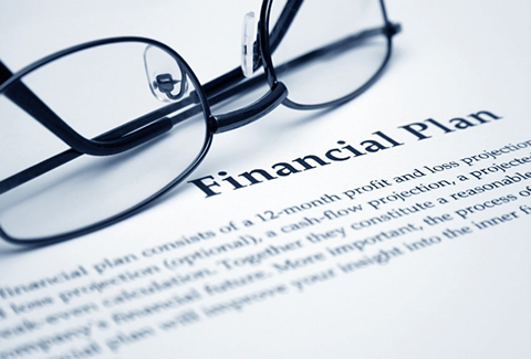 Close up picture of a financial plan with the heading