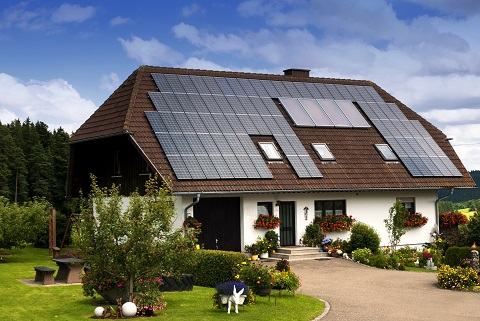 An exquisite home with the walls adorned with flowers and solar cells installed on the roof.