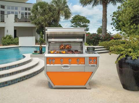 The swimming area of a large house with a gray and orange grill, designed to complete the overall house decor.