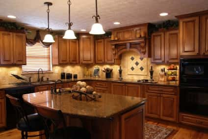 A traditional kitchen example complete with rich wooden furniture, cabinets, surfaces and decor items.