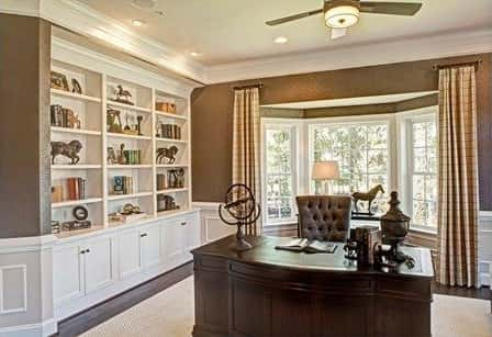 An example of a beautifully-designed and furnished home study done by the Heartland Homes Company.