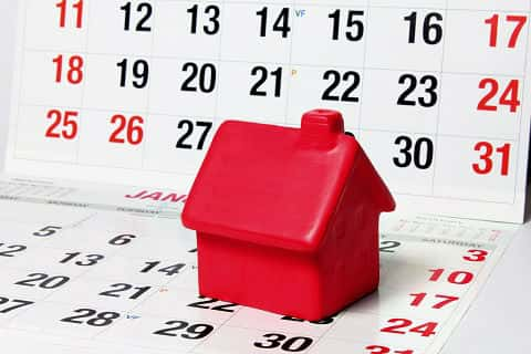 Estimation of a home completion time is represented by a small red house sitting on a calendar.