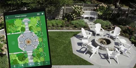Perfect translation of a brilliant 3D model of outdoor firepit design on a tablet to an outdoor environment.