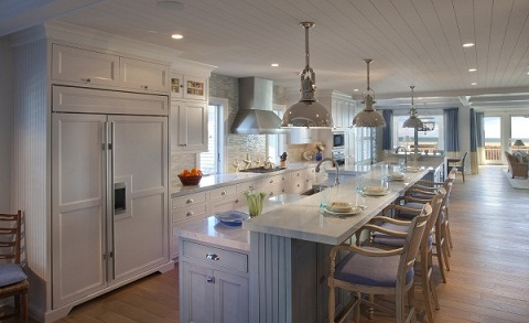 A long rectangular gray-themed kitchen filled with different items all within the gray color scheme.