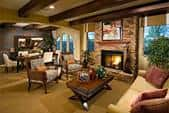 An impeccable home design capturing the sitting room close to the fire place and the dining room.