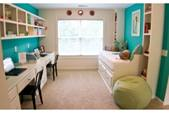 A colorful kids study room full of child-safe, comfortable furniture and decor items, perfect for playing.