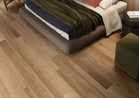 A section of a bedroom floor showing a special type of tile that looks like wooden flooring.