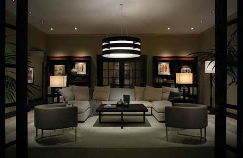 A living room with trendy Lutron lighting, which dims the room and brings out a warm feel.