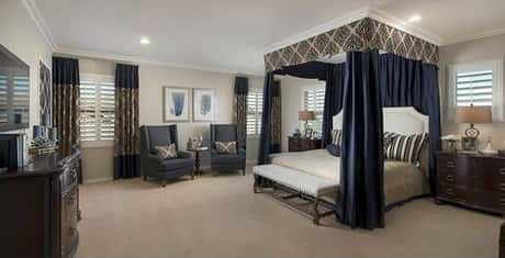 A large master bedroom, beautifully and elegantly designed using matching items owned by Meritage Homes.
