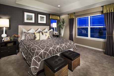 One of the breathtaking bedroom designs from Meritage Homes with blue windows to filter the rays of the sun.