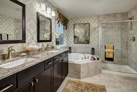 a very big bathroom with a large bathtub in the corner of the room and