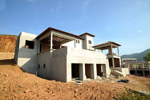 A home build by the side of a sloping terrain is designed to withstand the pressure of soil movement.