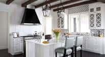 White-themed, detailed, modern kitchen full of intricate and creative design items pleasing to the eye.
