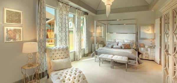 Great looking bedroom with large glass windows designed with vintage items all either white or off-white.