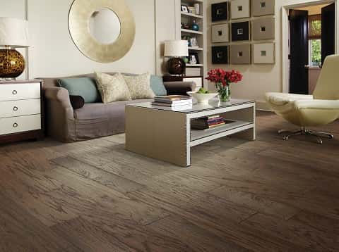 An elegantly-designed and decorated indoor lounge space featuring timeless and durable hardwood flooring material.
