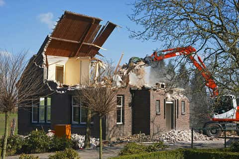 A Chocolate Colored House Being Destroyed By A Red Caterpillar The Surrounding Environment Is