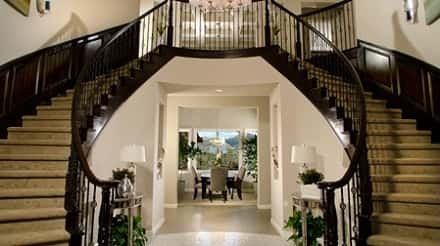 A Pair Of Elegant And Beautifully Designed Staircases Leading The Way To  The Upstairs Spaces