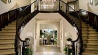 A pair of elegant and beautifully-designed staircases leading the way to the upstairs spaces.
