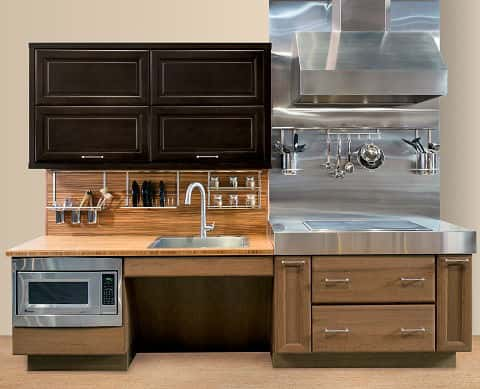 A section of a simple but fantastic kitchen complete with modern appliances, environmental gadgets, a stove, a sink and cabinets.