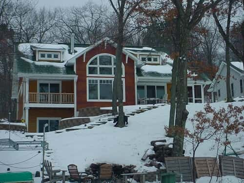 Red exterior of home in the winter. Photo courtesy of TJ Specialty Construction, KKC, Brainerd, MN.