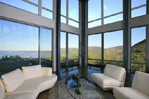 "Dynamic, or ""switchable"" or ""smart,"" windows, are windows that change from clear to opaque or that can be tinted when the sun or heat hits them, as shown here in this home."