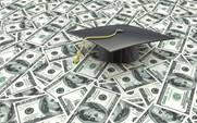 Mini graduation cap on US money — education costs in the design of information related to the cost of education