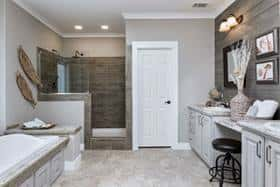 The master bathroom in this Clayton Homes home is stunning and spacious.