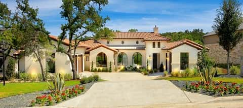 The Santa Anita plan by Ash Creek Homes is a Santa Barbara-style home in the Texas Hill Country. The four-bedroom, three bath home is designed for empty nesters or 55-plus home shoppers.