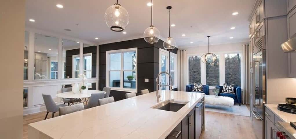 "<p>Again, Pulte reinforces our theory that using <a href=""https://www.newhomesource.com/guide/articles/heres-how-to-make-a-statement-in-your-kitchen-with-black"" target=""_blank"" title=""NewHomeSource, ""Here's How to Make a Statement in Your Kitchen with Black,"" by Camilla McLaughlin"">black in the home is a hot trend</a>, particularly in the kitchen.</p> <p> </p> <p>Using black in the home won't darken the space, since you'll want to contrast it with bright colors. ""Matte black is being widely used in design as it adds a grounding contrast to light, neutral design schemes,"" says the Pulte design team. Don't be afraid of using black throughout the home; it'll add a richness you never thought it could.</p> <p> </p> <p><em>Photo courtesy of The Wilbert Group</em></p>"