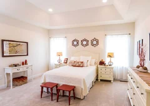 The bright splashes of color added to this bedroom make it fresh and trend-worthy. Olde Forge Station Plan by Berks Homes in Carlisle, Penn.