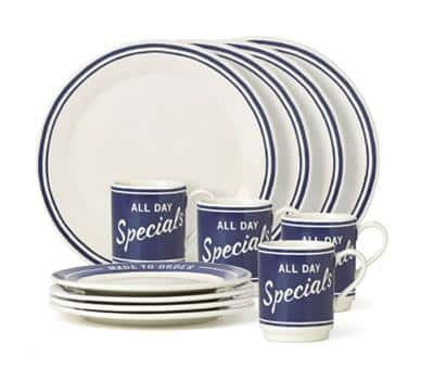 "Dinnerware set including white plates with navy blue bands around the outer edge of plate, smaller plates with thick blue band around the edges with white lettering that says ""Made to Order"" and white coffee mugs with blue screen and white lettering that says ""All Day Specials."""