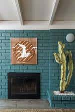 Brick wall painted in The Green Hour, a grayed blue-green color chosen as Dunn-Edwards' 2018 Color of the Year.