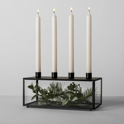 A glass and black metal taper candle holder from the Hearth & Hand with Magnolia line from Target.