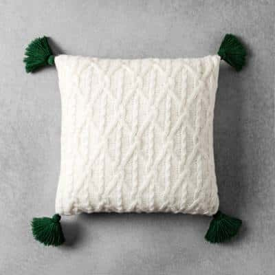 Cream cable knit throw pillow with dark green tassels from the Hearth & Hand with Magnolia line from Target.