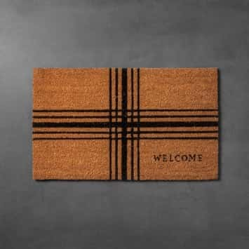 A coir doormat with a centered plaid pattern from the Hearth & Hand with Magnolia line from Target.