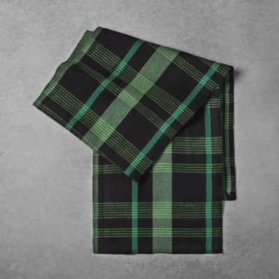 Green and black plaid-patterned woven table runner from the Hearth & Hand with Magnolia line from Target.