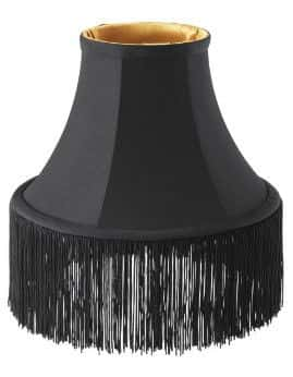 A black lamp shade with fringe is one item of the Omedelbar line from IKEA's collaboration with Bea Åkerlund.